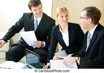Negotiations - Business man and woman looking at boss of...