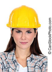 An unsatisfied female construction worker.