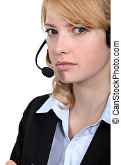 Bitter woman wearing a headset