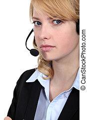 Bitter woman wearing a headset