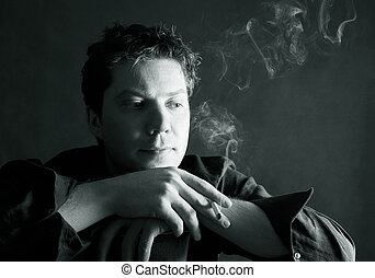 Man with a cigarette - The thoughtful man with a cigarette...
