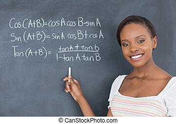 Student showing a blackboard