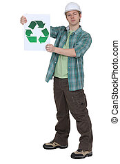 craftsman holding a recycling label