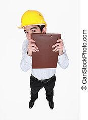 Man hiding behind a clipboard