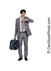 Man with suitcase looking at the time