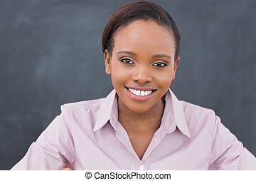 Front view of a teacher looking at