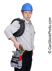 Electrician carrying a voltmeter