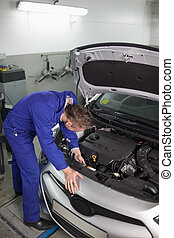 Mechanic repairing a car in a garage