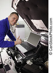 Mechanic working on a computer