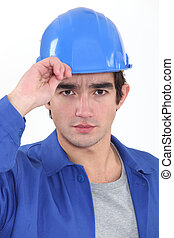 A construction worker saluting.