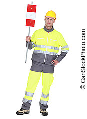 construction worker in safety outfit holding construction...