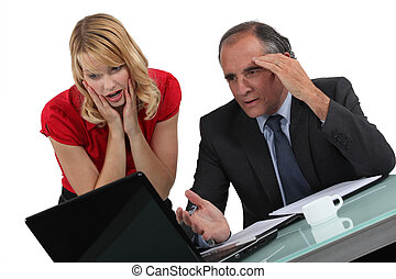 Businessman and woman facing a problem