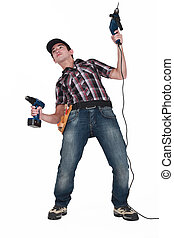 Man fooling about with two power drills