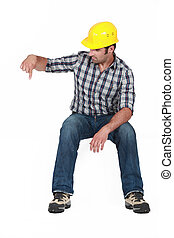 Construction worker pointing down