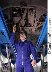 Mechanic repairing a car with an adjustable pliers in a...