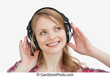 Woman listening music against a white background