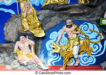 Deities - Wall statues of a Buddhist temple.