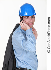 Man making call with jacket over shoulder