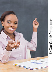 Focus on the hand on a teacher in a classroom