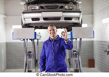 Mechanic doing a gesture with his hand