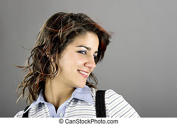 Smilling - Porttait of a young woman smilling on a grey...