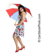 Umbrella woman - Portrait of a young happy woman posing with...