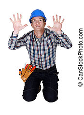 Tradesman pressing his hands against a see-through wall