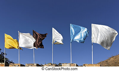 Flags fluttering against blue Sky - Generic image of plain...