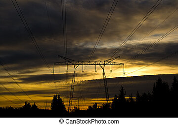 Powerlines. - silhouette of powerlines and a yellow/golden...