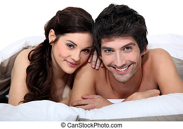 Portrait of a young couple in bed