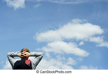 Business relax of the businessman and blue sky