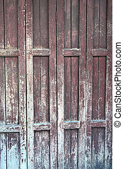 wooden door with a faded paint