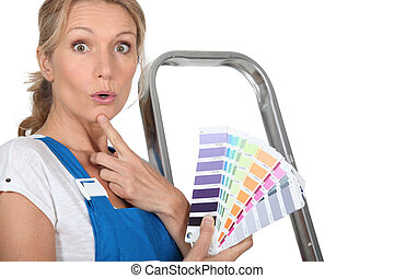 Blond woman choosing paint colour