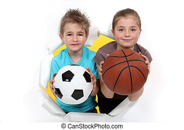 Children with a football and basketball