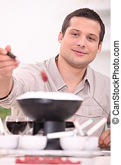Young brunette with fondue