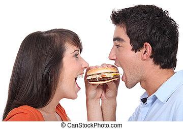 young people eating hamburger