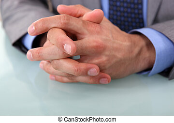 Human hands clasped