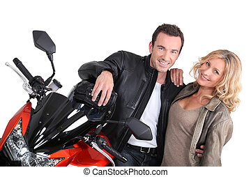 Biker couple with hand on shoulder.