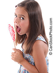 Girl eating heart lolly pop
