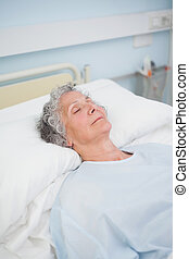 Patient sleeping on a bed