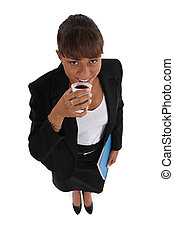 attractive young businesswoman having coffee