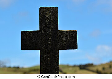 Stone cross - A stone cross against the landscape of...