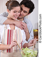 Couple making salad in the kitchen