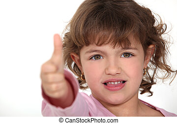 Little girl giving thumbs-up gesture