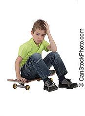Little boy with skate board