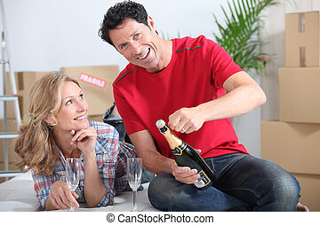 Couple celebrating new house