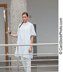 Patient walking in the corridor