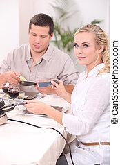 Couple eating a raclette