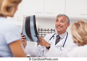 Doctor examining the X-ray of a patient