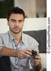Young man playing video games alone